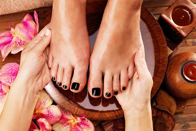 Massage of woman's foot in spa salon
